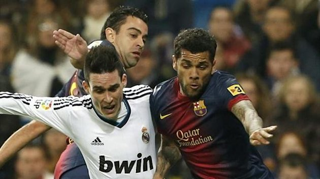 Jose Callejon tussles with Dani Alves