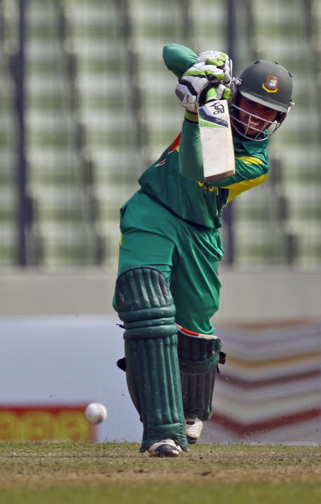 Bangladeshi Mominul Haque plays a shot during the third one day international cricket match against Sri Lanka in Dhaka, Bangladesh, Saturday, Feb. 22, 2014. (AP Photo/A.M. Ahad)