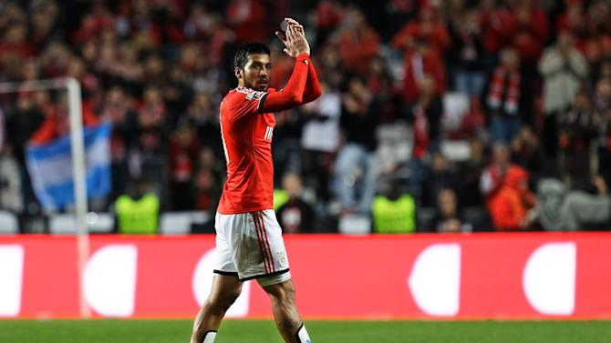 Benfica's Ezequiel Garay applauds the supporters as he leaves the pitch during their Portuguese league soccer match with Porto Sunday, Jan. 12 2014, at Benfica's Luz stadium in Lisbon. Garay scored the second goal in Benfica's 2-0 win