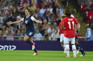 Carli Lloyd celebrates scoring for the US against Japan during London Olympics women's football final. Lloyd scored both goals in the Americans' 2-1 victory over Japan