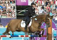 """Lithuania's Laura Asadauskaite competes on All Rise during the riding show jumping part of the women's Modern Pentathlon during the 2012 London Olympics at the Equestrian venue in Greenwich Park, London. Modern pentathlon was hailed as a """"James Bond"""" sport on Sunday as the gruelling multi-discipline event brought the curtain down on the London Olympics"""