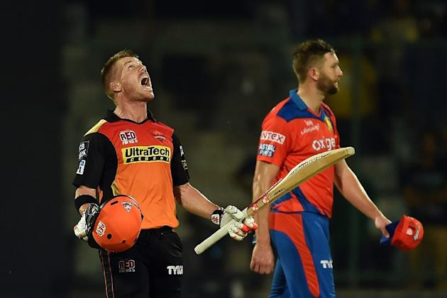 Sunrisers Hyderabad captain David Warner (L) celebrates the victory over Gujarat Lions during the 2016 Indian Premier League Twenty20 qualifier match in New Delhi on May 27, 2016