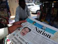 A man reads a newspaper bearing the photograph of Pakistani surgeon Shakeel Afridi, recruited by the CIA to help find Osama bin Laden, at a newsstand in Karachi. Angry US lawmakers Thursday threatened to freeze millions of dollars in vital aid to Islamabad after a Pakistani doctor who helped hunt down Osama bin Laden was jailed for 33 years
