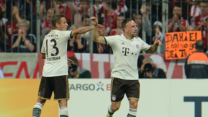 Munich's Rafinha of Brazil. left, and Franck Ribery of France celebrate after scoring during the German soccer cup second round match between FC Bayern Munich and Hannover 96, in Munich, southern Germany, Wednesday, Sept. 25, 2013