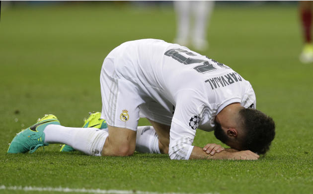Real Madrid's Dani Carvajal lies on the pitch in pain during the Champions League final soccer match between Real Madrid and Atletico Madrid at the San Siro stadium in Milan, Italy, Saturday, May