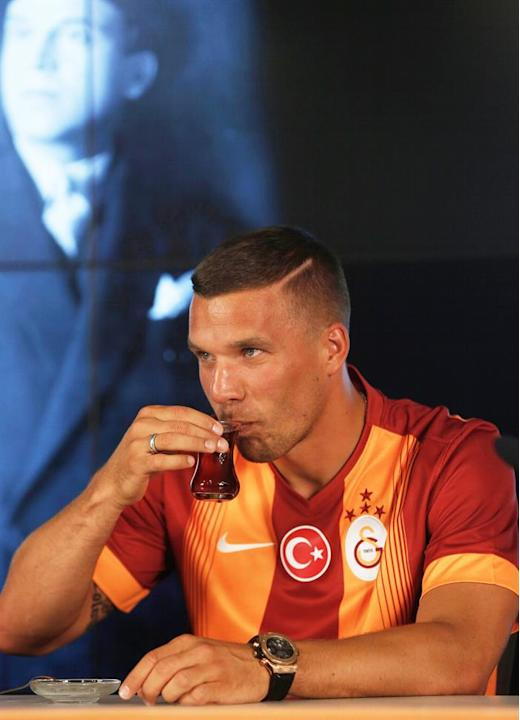 ULS01. Istanbul (Turkey), 04/07/2015.- German forward Lukas Podolski drinks tea during a press conference for his presentation as new player of Turkish Super League soccer club Galatasaray in Istanbul