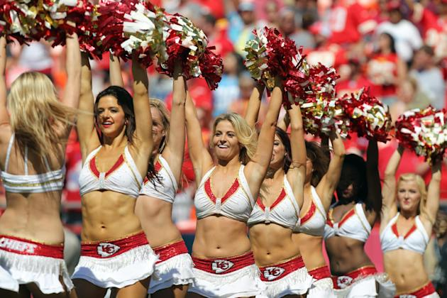 Kansas City Chiefs cheerleaders perform in the second half of an NFL football game between Chiefs and the Tennessee Titans in Kansas City, Mo., Sunday, Sept. 7, 2014. (AP Photo/Ed Zurga)