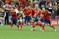 Spanish players celebrate at the end of the penalty shoot out of the Euro 2012 football championships semi-final match Portugal vs. Spain at the Donbass Arena in Donetsk. Spain reached their third consecutive major tournament final after overcoming neighbours Portugal 4-2 on penalties