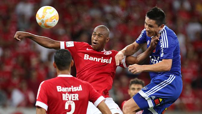 Canales of Chile's Universidad de Chile jumps for the ball with Costa of Brazil's Internacional during their Copa Libertadores soccer match in Porto Alegre