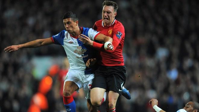 Manchester United's English Defender Phil Jones (C) Vies With Blackburn Rovers' English Midfielder Jason Lowe (L) And AFP/Getty Images