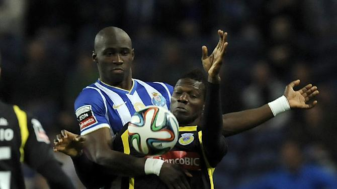 FC Porto's Eliaquim Mangala, left, from France challenges Arouca's Salim Cisse, from Guinea Conakry, in a Portuguese League soccer match at the Dragao stadium, in Porto, Portugal, Sunday March 9, 2014. Porto won 4-1