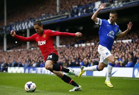 Everton's Mirallas challenges Manchester United's Hernandez during their English Premier League soccer match in Liverpool