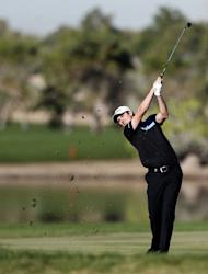 England's Justin Rose plays a shot during the second round of the Abu Dhabi Golf Championship at the Abu Dhabi Golf Club in the Emirati capital on January 18, 2013. Rose was the leader at the halfway stage at eight under par after a 69