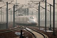A high-speed train departs a platform in Hebei province, south of Beijing, on December 22, 2012. China has started service on the world's longest high-speed rail route, Beijing to Guangzhou, the latest milestone in the country's rapid and -- sometimes troubled -- super fast rail network