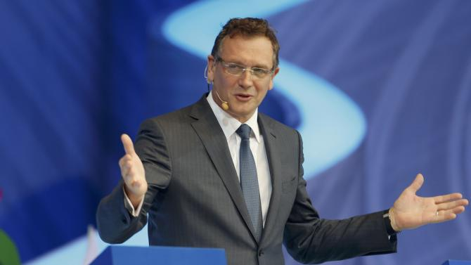 Valcke gestures as he presents draw for the 2014 World Cup in Sao Joao da Mata