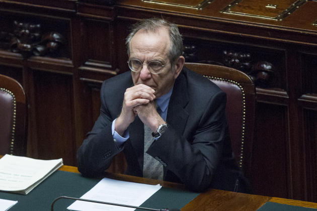 Italian Finance Minister Pier Carlo Padoan attends a Parliament session in Rome, Thursday, April 17, 2014. Italy has again pushed back its balanced-budget goal, now aiming for 2016. Finance Minister P