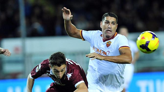 AS Roma forward Marco Borriello, right, challenges for the ball with F.C. Torino defender Matteo Darmian during a Serie A soccer match between F.C.Torino and AS Roma at Turin's Olympic stadium, Italy, Sunday, Nov. 3, 2013