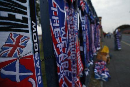 Scarves and flags are seen for sale outside Ibrox Stadium before the Rangers versus Inverness Caledonian Thistle soccer match in Glasgow