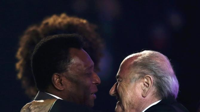 Pele greets Blatter during the draw for the 2014 World Cup in Sao Joao da Mata