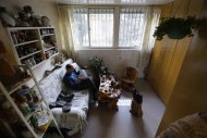 51 year-old Tian Lianpu, father of the late Tian Yao, born in August 1990 and died in January 2012 of lymphoma, looks at his mobile phone as he drinks tea at home in Beijing, December 26, 2013. REUTERS/Jason Lee