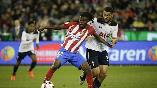 Tottenham's Cameron Carter-Vickers in action with Atletico Madrid's Thomas Partey