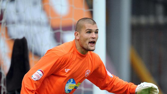 Torquay boss Martin Ling says Peterborough have made three enquiries for Robert Olejnik (pictured)