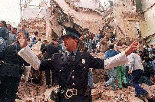 A policeman prevents people from approaching the site where a powerful explosion destroyed a building housing a Jewish aid society in Buenos Aires in 1994. Argentina soon will propose an agenda to Iran on talks to settle lawsuits related to the 1994 bombing that killed 85 people, authorities said Saturday