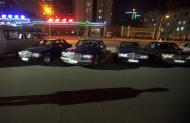 In this April 12, 2011 photo, a shadow is cast across a parking lot as a man walks by a row of imported cars in central Pyongyang, North Korea. (AP Photo/David Guttenfelder)