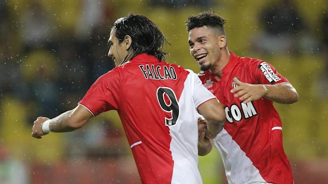 Monaco's Falcao of Colombia is congratulated after scoring the second goal  by his teammate Emmanuel Riviere of France  during their French League One soccer match against Bastia, in Monaco stadium, Wednesday, Sept, 25, 2013