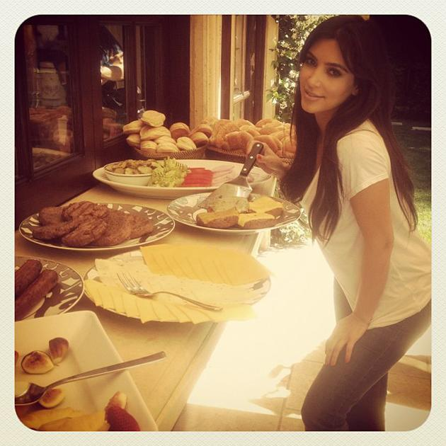 Celebrity photos: Kim Kardashian enjoyed a family BBQ over the weekend and tweeted this cute picture of herself waiting to tuck into all the food.