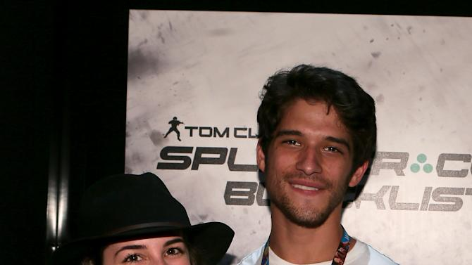 Tyler Posey, left,  is seen at the Ubisoft booth on Day 1 of E3, Tuesday, June 11th, 2013 in Los Angeles. (Photo by Alexandra Wyman/Invision for Ubisoft/AP Images)