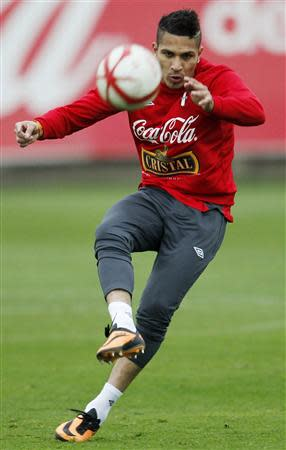 Peru's national soccer player Paolo Guerrero kicks a ball during a training session in Lima