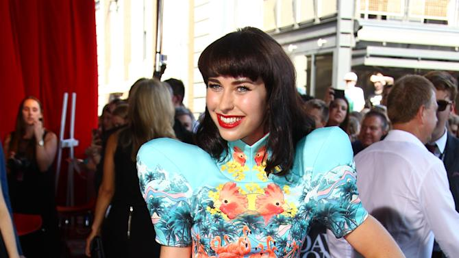 Kimbra Lee Johnson poses for photographers upon arrival for the Australian music industry Aria Awards in Sydney, Thursday, Nov. 29, 2012. (AP Photo/Rick Rycroft)