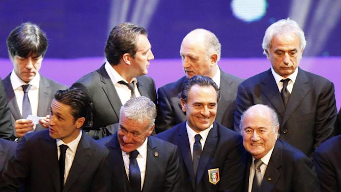 FIFA President Blatter smiles alongside Italy's coach Prandelli and France's coach Deschamps during their group photo after the draw for the 2014 World Cup finals was made at the Costa do Sauipe resort in Sao Joao da Mata
