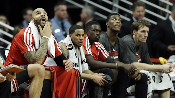 Chicago Bulls forward Carlos Boozer, left, reacts as he looks up a score board with his teammates during the second half of an NBA basketball game against the Toronto Raptors in Chicago on Saturday, Dec. 14, 2013. The Raptors won 99-77