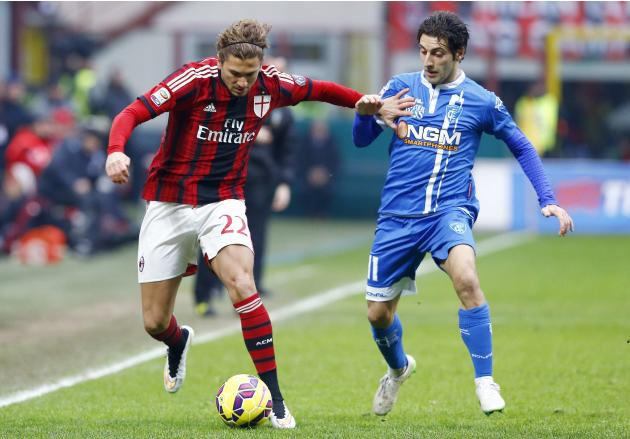 AC Milan's Cerci challenges Empoli's Croce during their Serie A soccer match at the San Siro stadium in Milan
