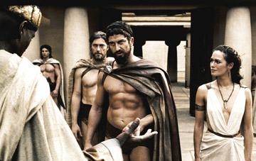 Leonidas ( Gerard Butler ) warns the Persian Messenger ( Peter Mensah ) to choose his words wisely as Captain ( Vincent Regan ) and Gorgo ( Lena Headey ) look on  Warner Bros. Pictures' 300