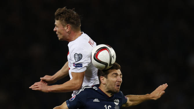 Poland's Lukasz Piszczek in action with Scotland's James McArthur