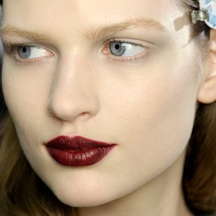 Model at Viktor and Rolf backstage wearing berry lips