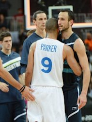 French guard Tony Parker is congratulated by Argentinian guard Manu Ginobili (R) after the Men's preliminary round group A basketball match of the London 2012 Olympic Games France vs Argentina at the basketball arena in London. France won 71 to 64