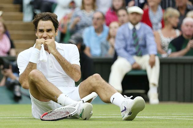 Roger Federer of Switzerland celebrates match point during his Gentlemen's Singles final match against Andy Murray of Great Britain on day thirteen of the Wimbledon Lawn Tennis Championships at the Al