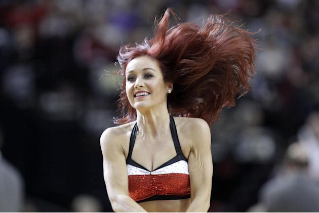 A Portland Trail Blazers dancer is shown during the second half of an NBA basketball game against the Los Angeles Clippers in Portland, Ore., Wednesday, April 16, 2014. (AP Photo/Don Ryan)