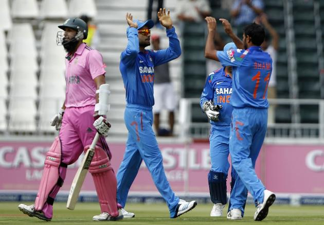 South Africa's Amla leaves crease as India's players celebrate dismissal after he was bowled out by Shami during 1st One-Day International in Johannesburg