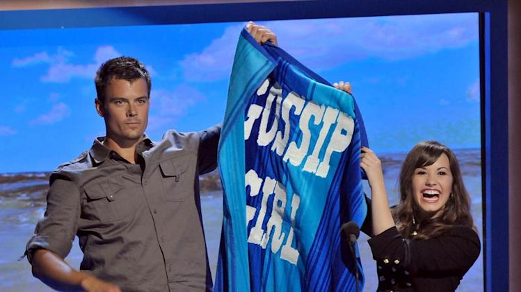 Actor Josh Duhamel and singer Demi Lovato onstage during the 2008 Teen Choice Awards at Gibson Amphitheater on August 3, 2008 in Los Angeles, California.