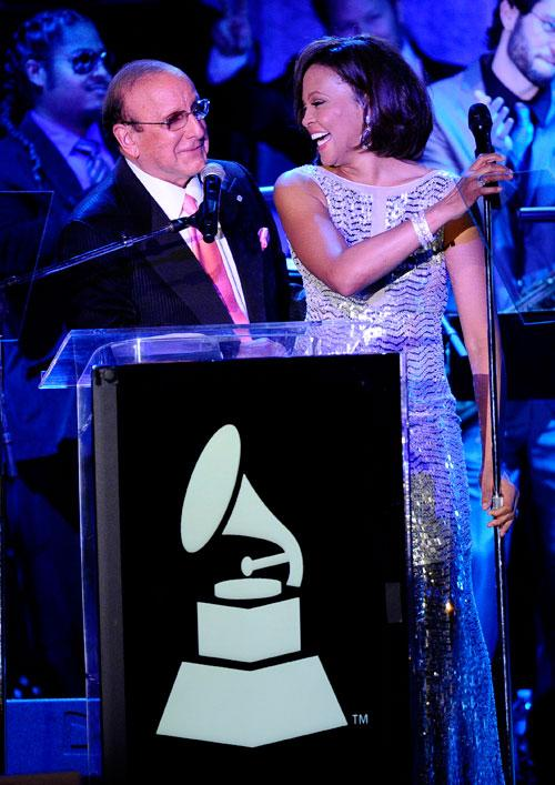 Producer Clive Davis (L) and singer Whitney Houston speak onstage at the 2011 Pre-GRAMMY Gala and Salute To Industry Icons Honoring David Geffen at Beverly Hilton on February 12, 2011 in Beverly Hills, California.Producer Clive Davis (L) and singer Whitney Houston speak onstage at the 2011 Pre-GRAMMY Gala and Salute To Industry Icons Honoring David Geffen at Beverly Hilton on February 12, 2011 in Beverly Hills, California.