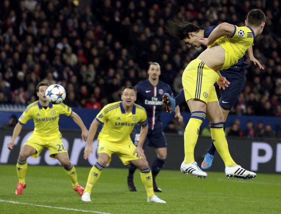 Paris St Germain's Edinson Cavani in action to score on goal during their Champions League round of 16 first leg soccer match against Chelsea at...