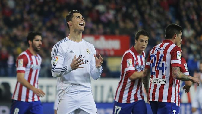 Real's Cristiano Ronaldo, centre, gestures during a semi final, 2nd leg, Copa del Rey soccer match between Atletico de Madrid and Real Madrid at the Vicente Calderon stadium in Madrid, Spain, Tuesday, Feb. 11, 2014