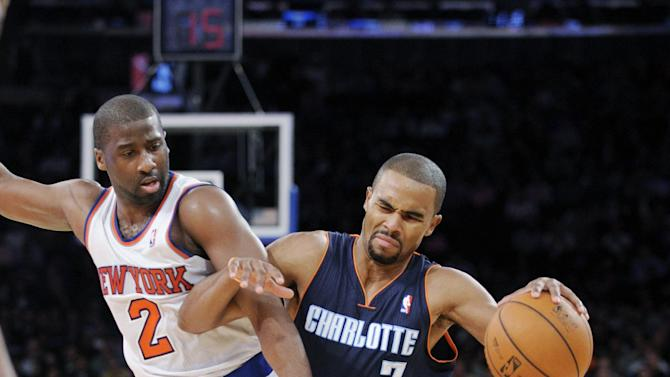 Charlotte Bobcats' Ramon Sessions, right, drives to the basket against New York Knicks' Raymon Felton during the third quarter of an NBA basketball game Tuesday, Nov. 5, 2013, at Madison Square Garden in New York. The Bobcats defeated the Knicks 102-97