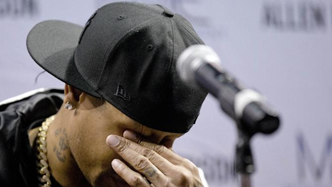 Former Philadelphia 76ers basketball player Allen Iverson wipes his eyes during a news conference Wednesday, Oct. 30, 2013, in Philadelphia. Iverson officially retired from thne NBA, ending a 15-year career during which he won the 2001 MVP award and four scoring titles. Iverson retired in Philadelphia where he had his greatest successes and led the franchise to the 2001 NBA finals