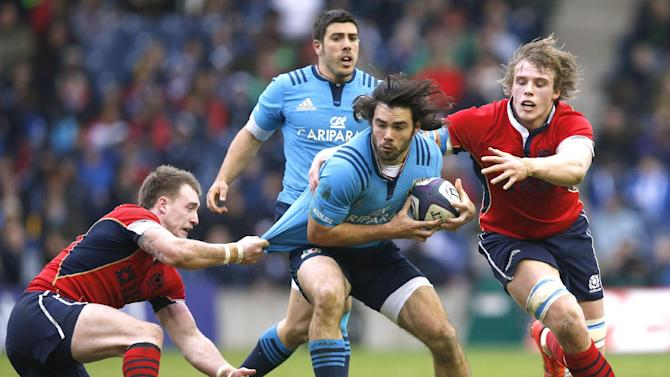 Rugby Union: Italy's Luke McLean tackled by Scotland's Stuart Hogg and Scotland's Jonny Gray